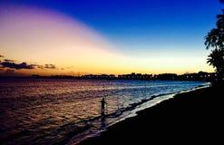 Рыболов захода солнца Стоковое Изображение