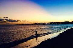 Рыболов захода солнца стоковое фото rf