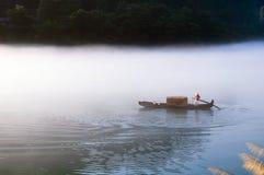 Рыболов и его собака Стоковое Фото