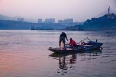 Рыболов и китайцы morden город Стоковые Изображения RF