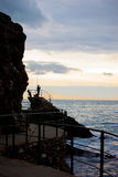 Рыболов на заходе солнца Стоковые Изображения RF