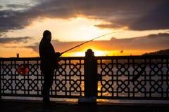 Рыболов на мосте Стоковое Изображение