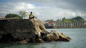 Рыболов на причале стоковое фото rf