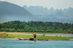 Рыболов на реке Li Стоковая Фотография