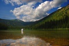 Рыболов озера гор Стоковое Изображение RF