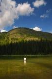 Рыболов озера гор Стоковое Фото