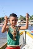 Рыболов омара на пляже Лос Cobanos Стоковое Фото