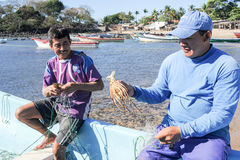 Рыболов омара на пляже Лос Cobanos Стоковое Изображение