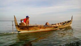 Рыболов отрезал море Стоковое фото RF