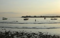 Рыболов Утро на острове Gili Trawangan, к северо-западу от Lombok, Индонезия Стоковая Фотография RF