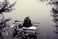Рыболов удит стоковые фотографии rf