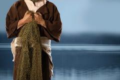 Рыболов Aplostle держа сети Стоковая Фотография
