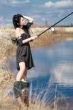 Рыбы женщины на озере Стоковая Фотография