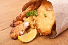 Рыбы и обломоки в бумаге ремесла стоковые фотографии rf