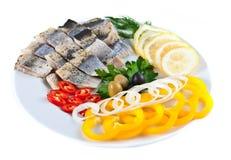 Рыбы на плите с овощами Стоковое Изображение