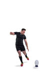 рэгби игрока шарика пиная Стоковое фото RF