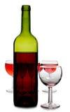 рюмки красного цвета бутылки Стоковые Фотографии RF