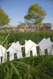Рядок бумажных домов Стоковые Изображения