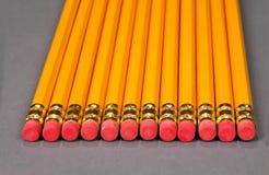 рядок карандашей истирателей Стоковое Изображение RF