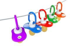 Рядок pacifiers младенцев с веревочкой Стоковое Изображение