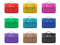 Ряд покрашенных satchels белая предпосылка Стоковая Фотография RF