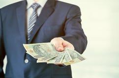 Ряд польских банкнот в руке бизнесмена Стоковое Изображение RF