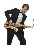 Саксофонист играя тяжелый рок саксофона с смешной стороной Стоковые Изображения