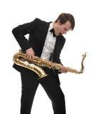 Саксофонист играя тяжелый рок саксофона с смешной стороной Стоковое Фото