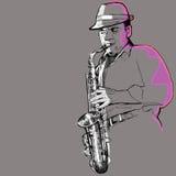 Саксофонист на серой предпосылке Стоковые Фотографии RF