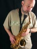 саксофон игрока Стоковая Фотография