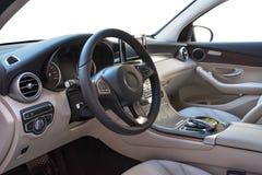 Салон автомобиля, дела класса на белой изолированной предпосылке стоковая фотография rf