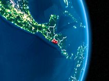 Сальвадор в красном цвете на ноче Стоковые Изображения