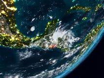 Сальвадор на земле на ноче стоковое фото rf