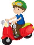 самокат riding мальчика Стоковые Фото