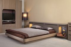 самомоднейшее красивейшей конструкции спальни нутряное стоковая фотография