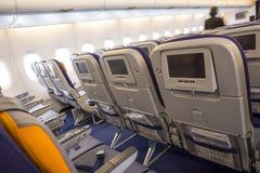 Самолет аэробуса A380 внутри мониторов LCD Стоковое фото RF