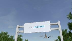 Самолет летая над афишей рекламы с логотипом Hyundai Мотора Компании Редакционное 3D представляя зажим 4K иллюстрация вектора