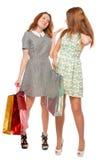 Самые лучшие подруги в платьях с хозяйственными сумками Стоковое фото RF