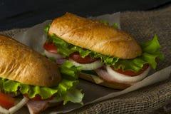 2 сандвича на бумаге выпечки Стоковое Фото