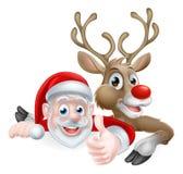 Санта и знак северного оленя Стоковые Фото