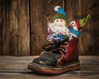 Санта и снеговик в санях северного оленя Стоковые Изображения
