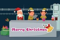 Санта и эльф делая подарок для с Рождеством Христовым Стоковая Фотография
