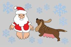 Санта Клаус и собака зодиака Стоковая Фотография