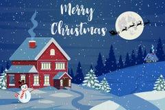 Санта Клаус летает над домом в снеге стоковые фото