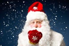 Санта Клаус на голубой предпосылке Стоковое Изображение