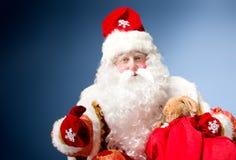Санта Клаус на голубой предпосылке Стоковые Изображения RF
