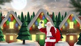 Санта Клаус перед украшенными домами в пейзаже зимы совмещенном с падая снегом акции видеоматериалы
