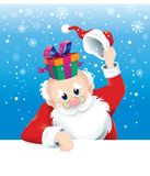 Санта Клаус с настоящим моментом сюрприза Стоковые Изображения