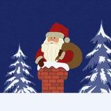 Санта Клаус с сумкой в печной трубе на голубой предпосылке Стоковое Фото