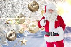 Санта Клаус держа его мешок подарка против цифров произведенной предпосылки рождества Стоковые Фотографии RF
